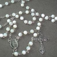 China Fresh Water Shell Rosary Necklace, Decorated with Metal Cross and Charms on sale