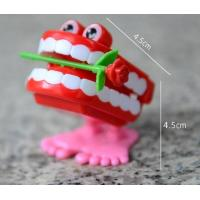 Buy cheap HOT FUNNY JUMPING TEETH CHATTERING SMILE TEETH SMALL WIND UP FEET TOY from wholesalers