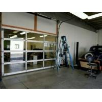 China Section Thickness 40/50mm Industrial Glass Garage Doors Motor Operate Anti Breaking on sale