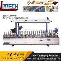 Profile wrapping machine with interchangeable wrapping zone