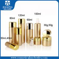 China Golden Metal Spray Glass Cosmetic Packaging With Lotion Cap For Skin Care wholesale