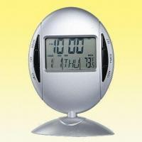 China Rotary Digital Clock with Thermometer and Calendar, Available in Oval Shape on sale