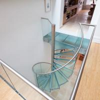 China Indoor Modern Design Glass Spiral Staircase With Stainless Steel Balustrade on sale