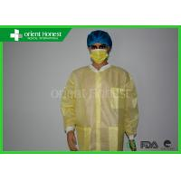 China Water Resistant Breathable Yellow Disposable Lab Coat With Pockets And Knitted Cuff on sale