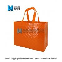 Cheap Orange high quality embossing image non woven tote bag shopping tote bag for sale