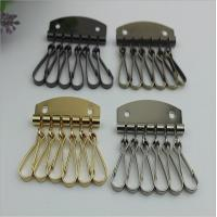 China Fashion Style Leather Key Chain Zipper Card Wallet Unisex Iron gold Keychain Holder with 6 Hooks Snap Closure on sale
