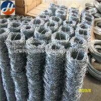 China Galvanized steel coiled barbed wire on sale