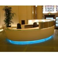 Bespoke Millwork reception counter in Pure white painting by tempered glass top with LED inside lighting