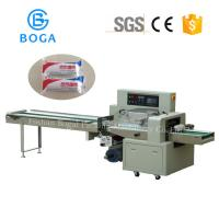 China Automatic High Speed Flow Wrapper Gauze Bandage Towel Roll Surgical Cotton Packaging machine on sale